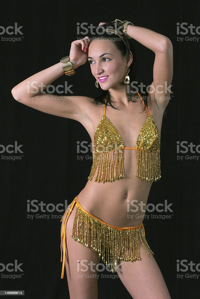 Sexy Oriental Dancer Wearing Gold Costume Royalty Free Stock Photo
