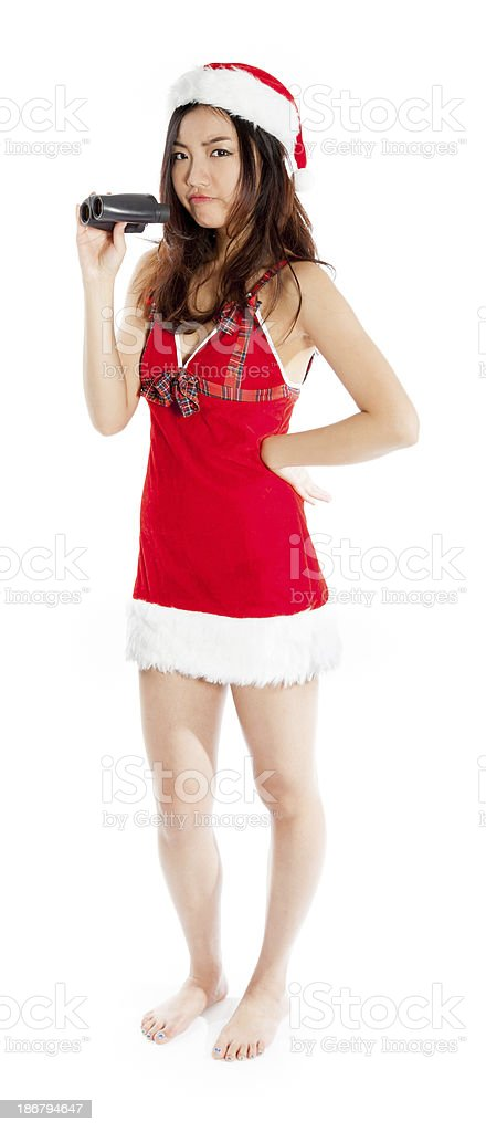 Sexy asian santa claus disapointed with binoculars royalty-free stock photo