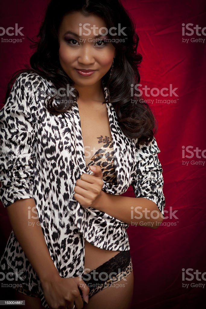 Sexy Asian Woman in Leopard Jacket stock photo