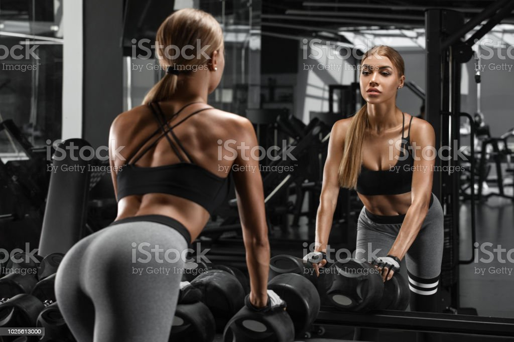 eacdbfb812e Sexy athletic girl working out in gym. Fitness woman doing exercise.  Beautiful butt in legging - Stock image .
