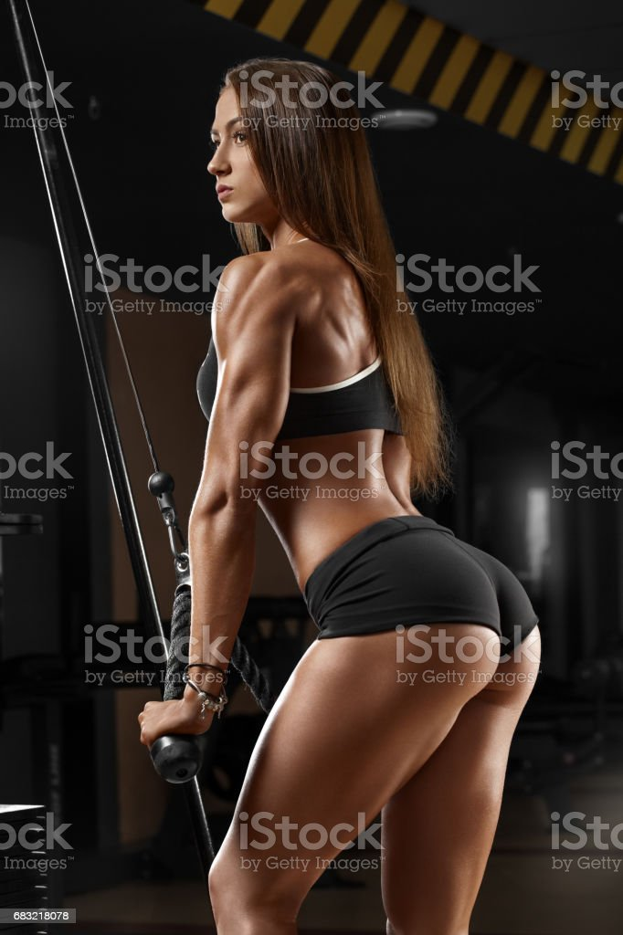 Sexy athletic girl working out in gym. Fitness woman doing exercise. Sexy beautiful butt in thong foto de stock royalty-free