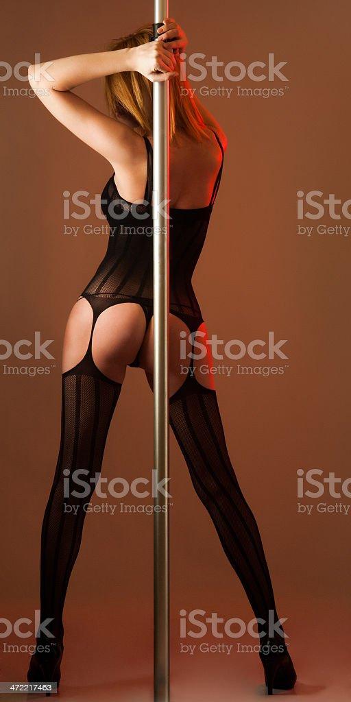 sexy back of pole dancer stok fotoğrafı