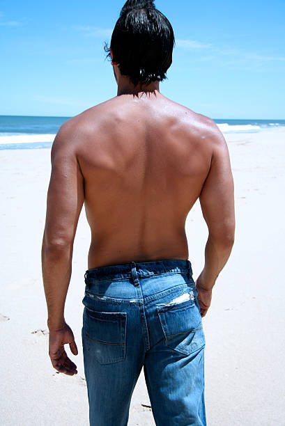 Sexy Back Sexy man walking on the beach hot sexy butts stock pictures, royalty-free photos & images