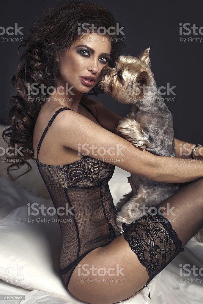Sexy beautiful brunette woman posing with dog. stock photo