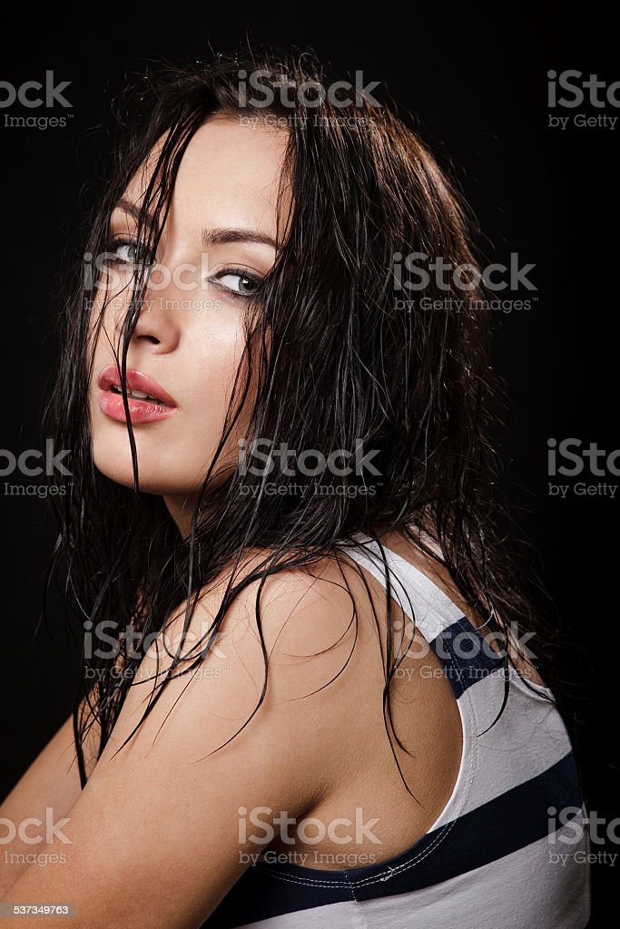 sexy beautiful woman with wet hair ufter sport training stock photo