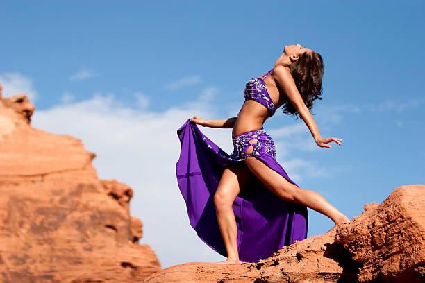 Sexy belly dancer girl exercising outdoors stock photo