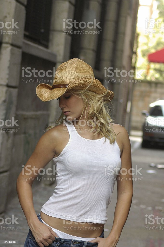 sexy blond cowgirl stock photo