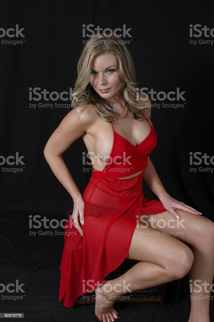 Sexy Blond in Red Lingerie Sitting royalty-free stock photo