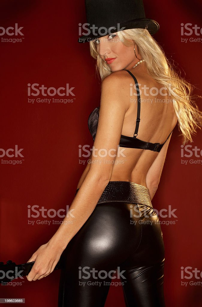 Sexy blond woman with guitar and top hat royalty-free stock photo