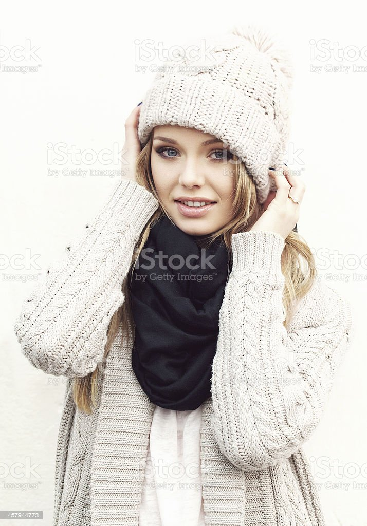 Sexy blonde girl in knited clothes stock photo