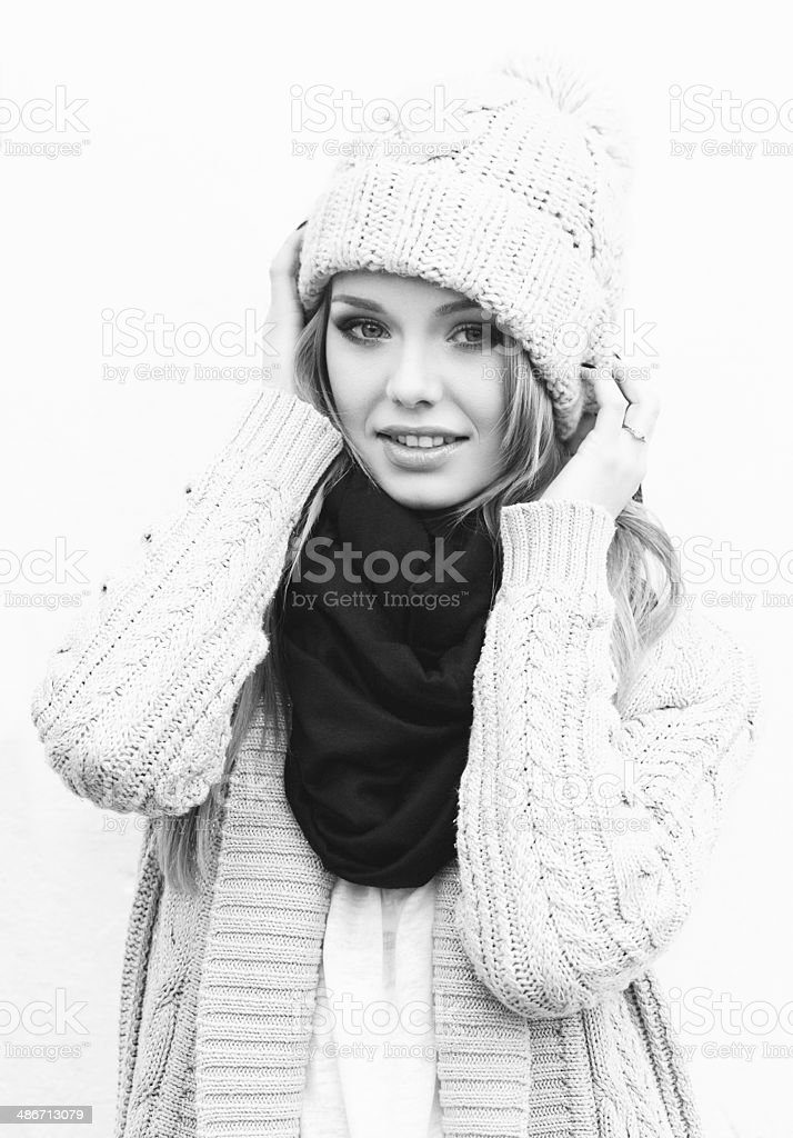 Sexy blonde girl in knitted clothes stock photo