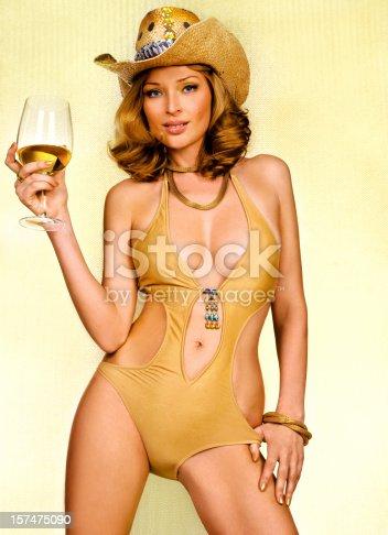 istock Sexy blonde in gold bikini 157475090