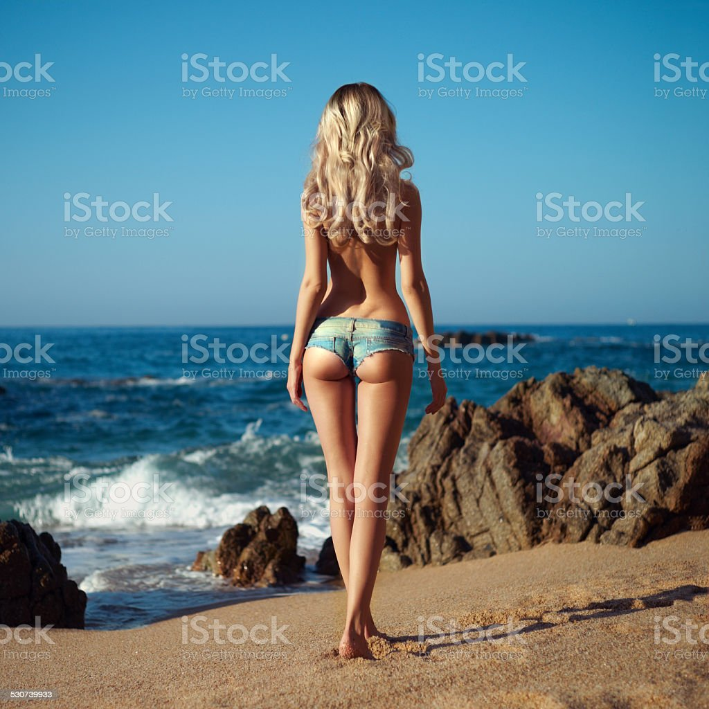 Sexy blonde on sea stock photo
