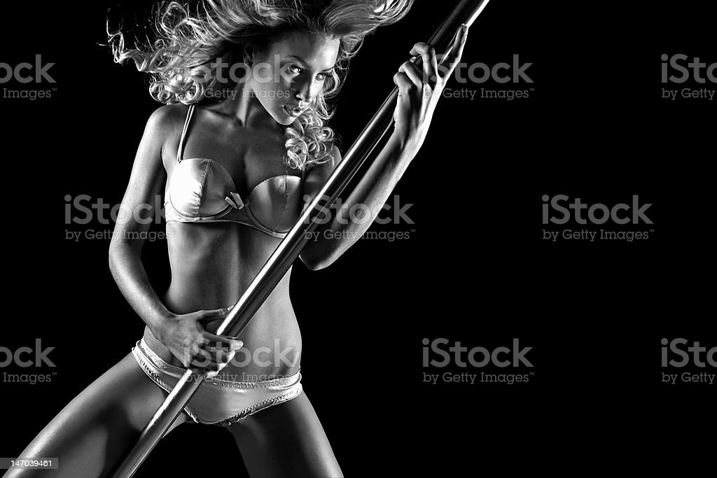 Sexy Blonde Pole Dancing in Lingerie stock photo