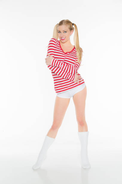 sexy blonde red and white shirt panties shorts - pigtails stock photos and pictures