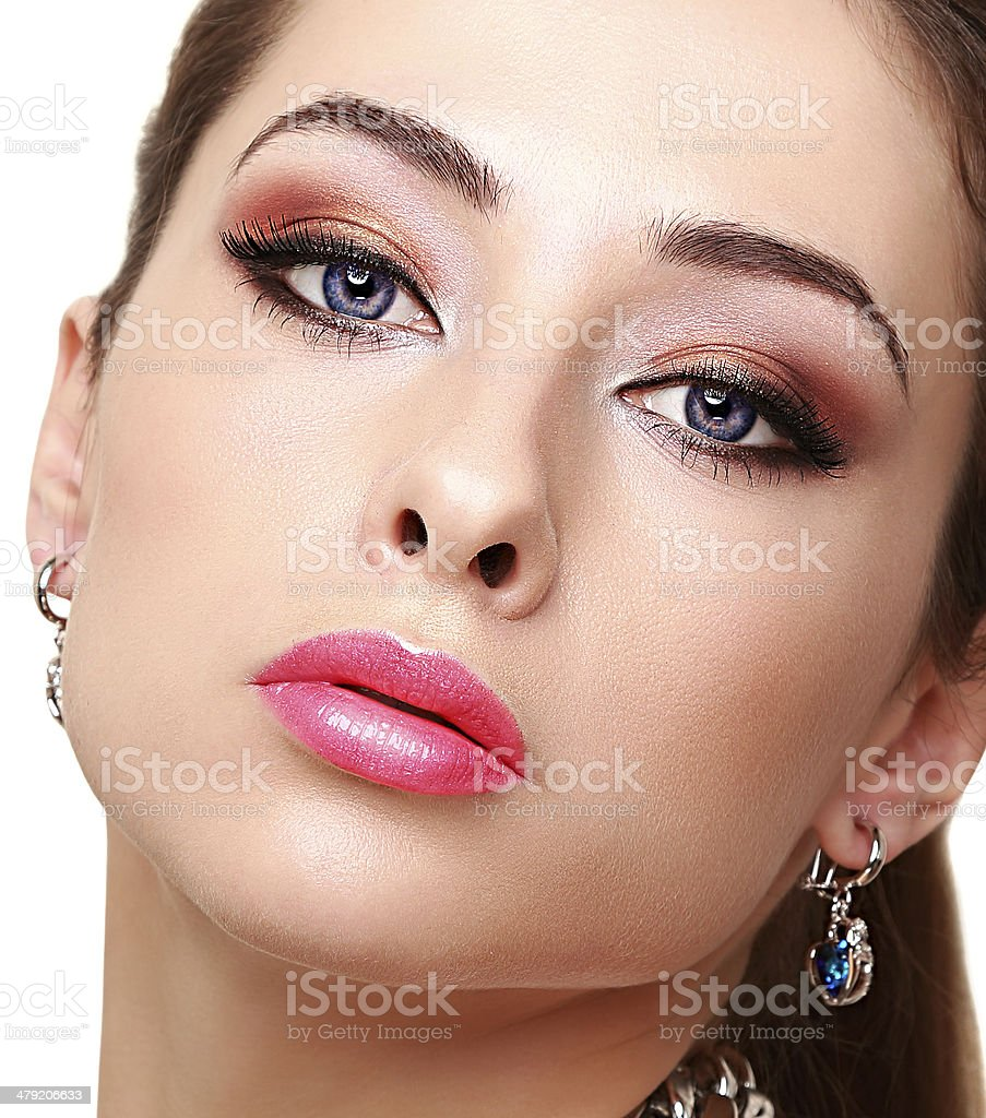Sexy bright makeup woman face with long lashes. Closeup stock photo