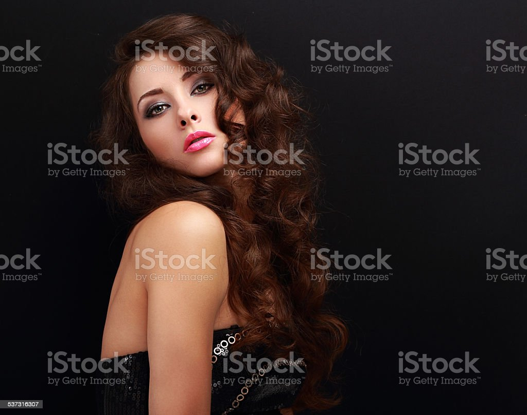 Sexy bright makeup woman with long curly hair posing stock photo