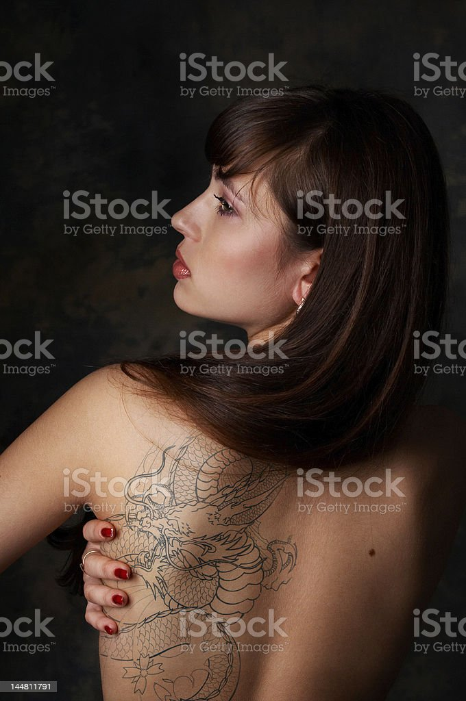 Sexy brunete with dragon royalty-free stock photo