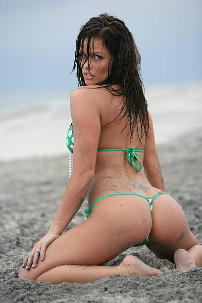 sexy brunette in a green thong  g string bikini models stock pictures, royalty-free photos & images