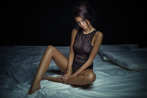 Sexy brunette lady in lingerie.