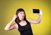 istock Sexy brunette making selfie. 538480011