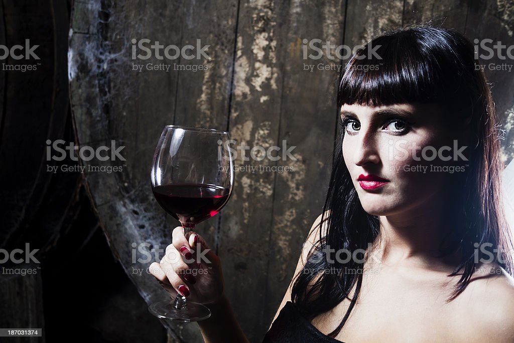 Sexy brunette with wine royalty-free stock photo