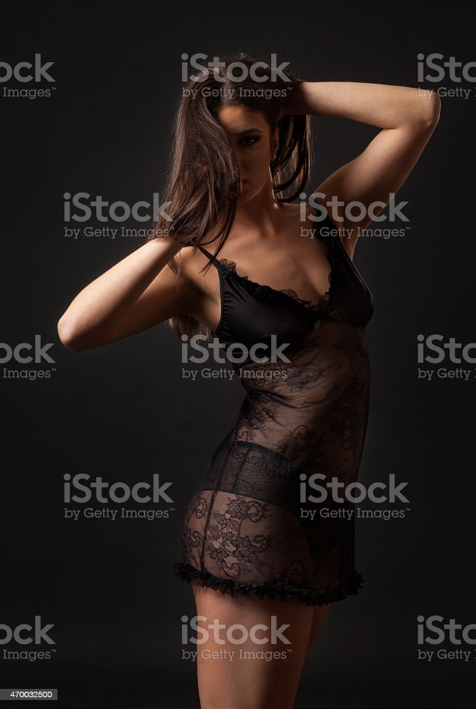 Sexy brunette woman in black tulle lingerie stock photo