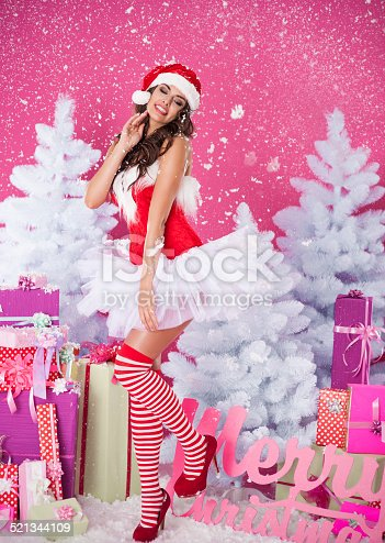 istock Sexy brunette woman in santa claus clothes 521344109