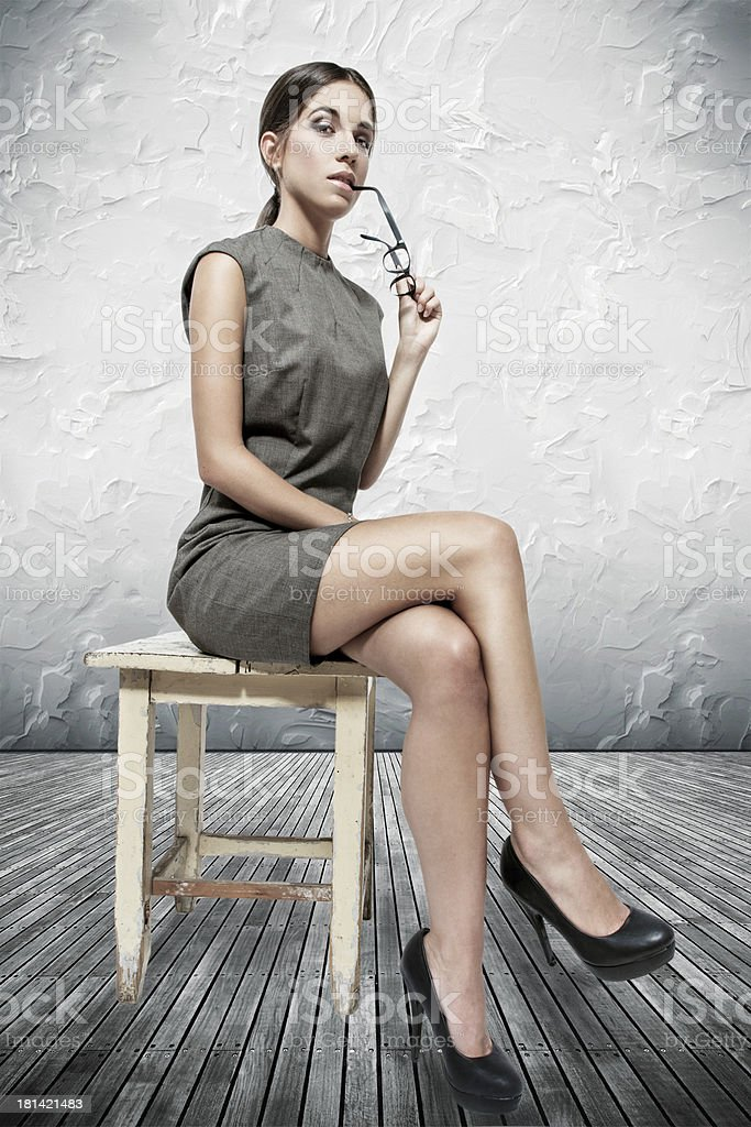 Sexy brunette woman sitting on stool royalty-free stock photo