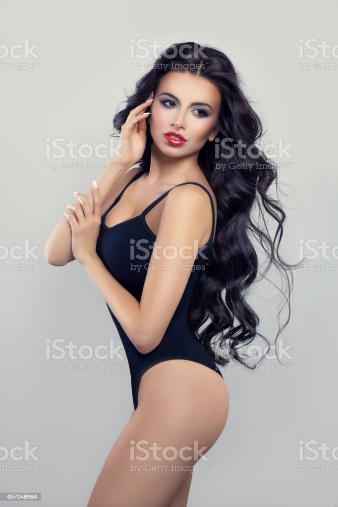 6cbc69e67 Sexy Brunette Woman with Long Dark Hair and Makeup. Fit Fashion Model on  Gray Background - Stock image .