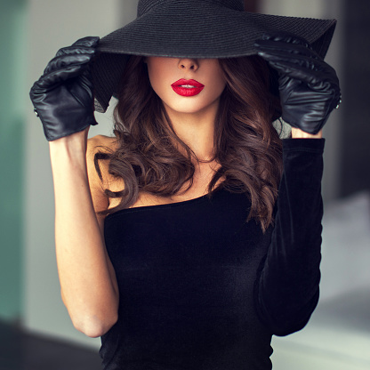 Sexy brunette woman with red lips in hat stock photo
