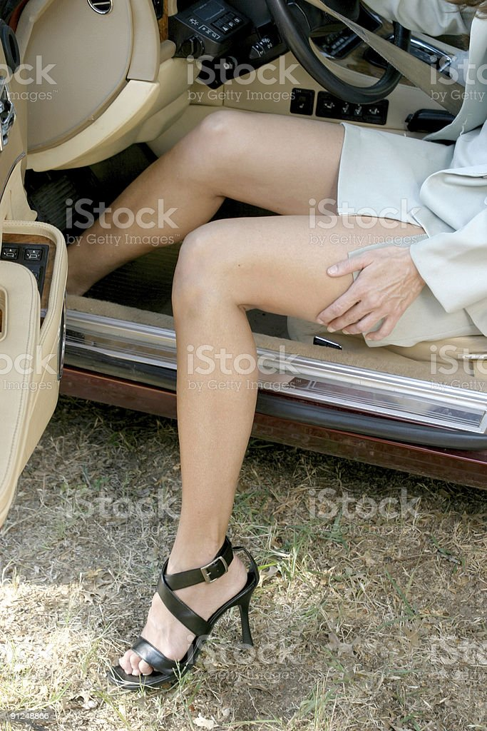 Sexy Business Woman Getting Out of Car 2 royalty-free stock photo