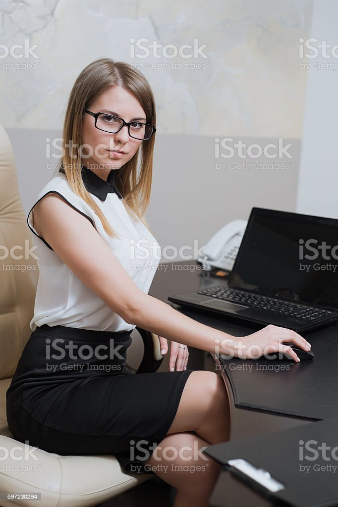 Sexy Business Woman Sitting At The Desk In Office Stock Image