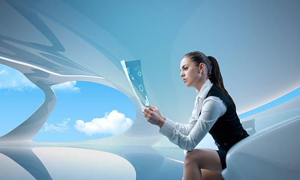 Sexy businesswoman examining future digital report / newspaper stock photo