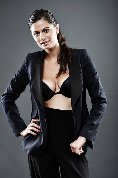Sexy Businesswoman Suit Over Nude Breasts Stock Photo