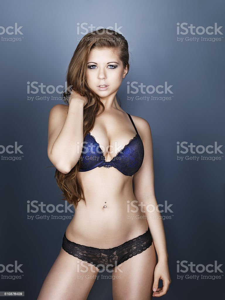sexy busty model in lingerie stock photo