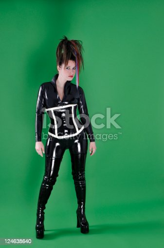 sexy young woman wearing a latex catsuit