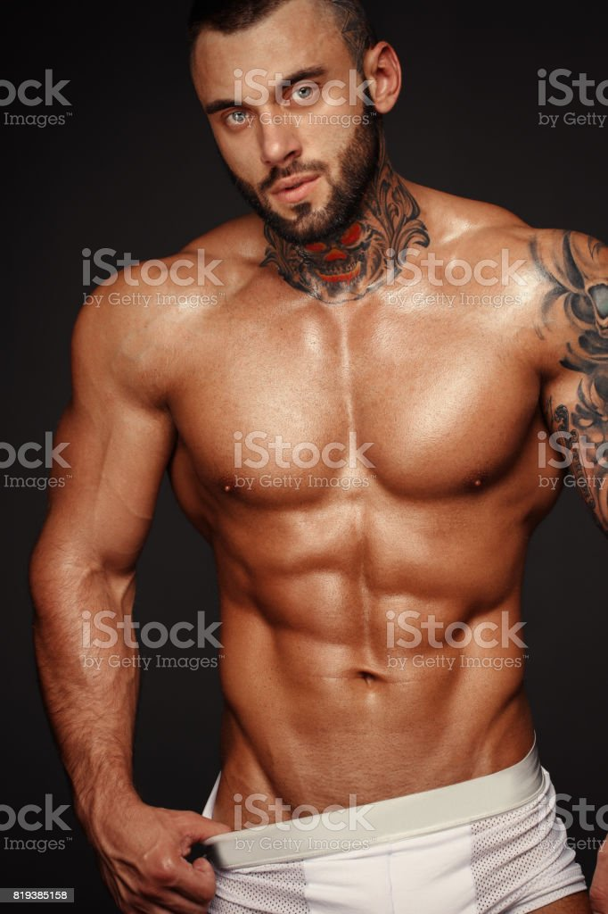 Sexy man or muscular macho, bodybuilder, with muscle torso, body with six  packs and abs poses on black background in white ...