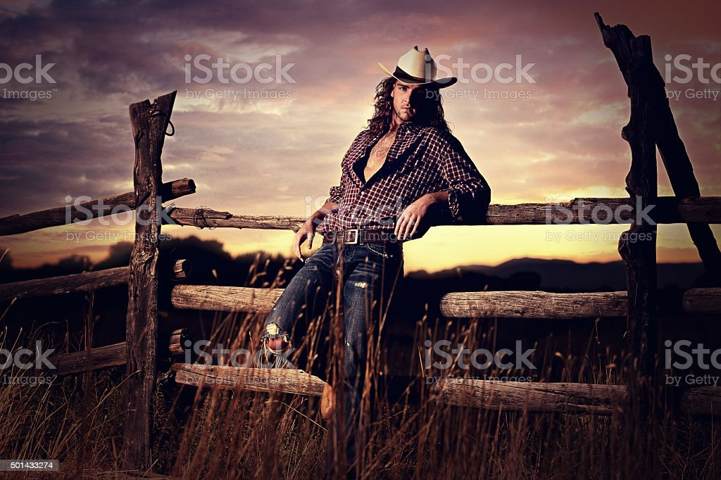 Sexy Country Cowboy In A Western Sunset stock photo