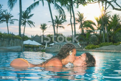 1065243116 istock photo Sexy couple, body at swimming pool palm resort near Hotel 951436502