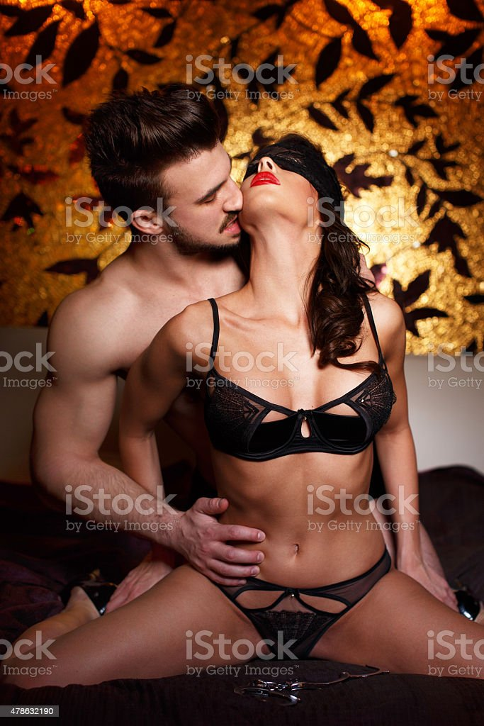 Sexy couple foreplay on bed at night stock photo