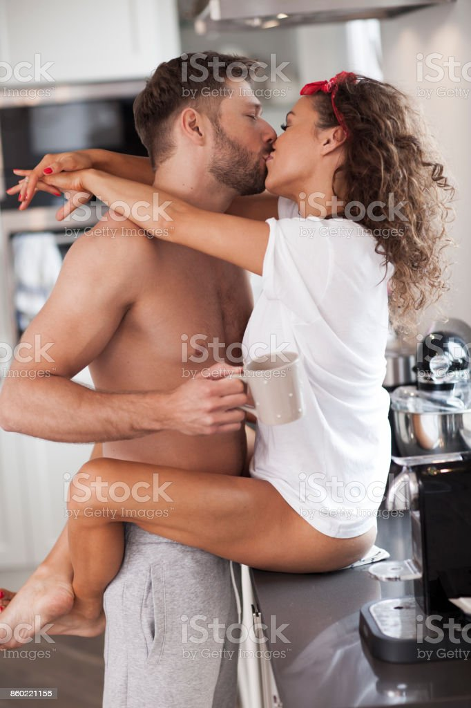 Sexy Couple Kissing In The Kitchen Stock Photo - Download -2930