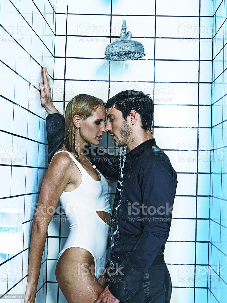Sexy couple kissing in the shower royalty-free stock photo