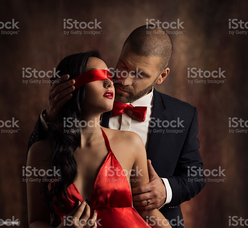 Sexy Couple Love Kiss, Fashion Man Kissing Sensual Woman, Blindfold stock photo