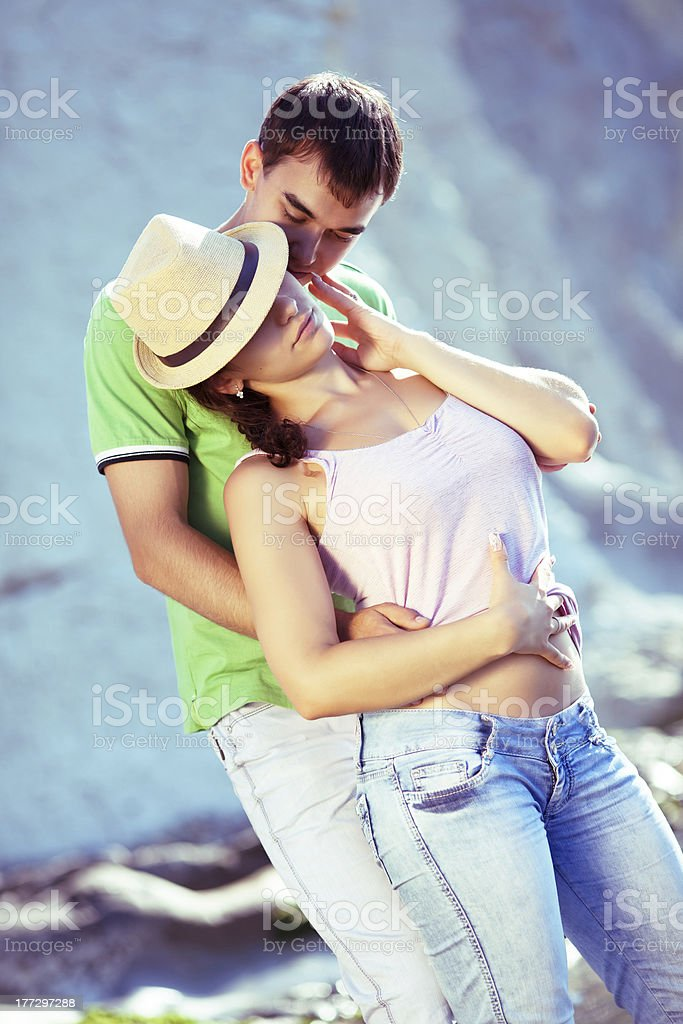 Sexy couple loving on the rocky coast royalty-free stock photo
