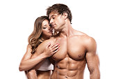 istock sexy couple, muscular man holding a beautiful woman 512725776