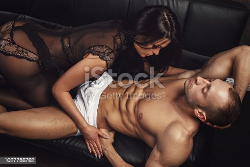 Sexy couple in underwear on leather sofa