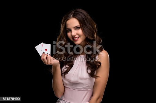 Sexy curly hair brunette posing with casino cards two aces in her hands, poker concept black background. Casino, poker, Roulette Blackjack Spin. Big win. winning combination