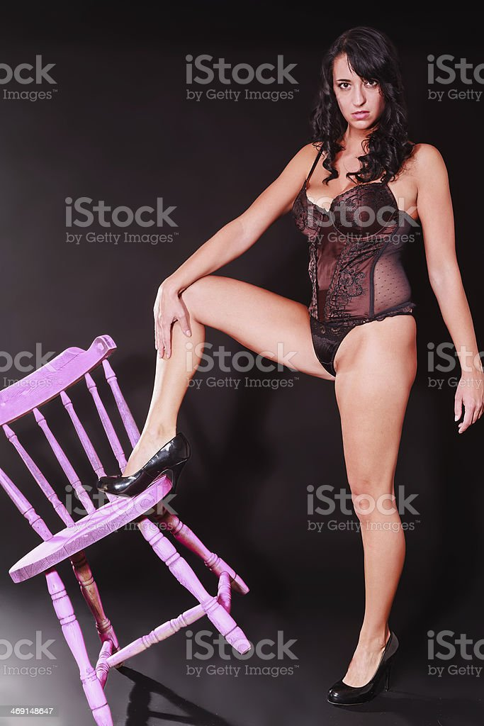 Sexy curvaceous woman posing in black lingerie stock photo