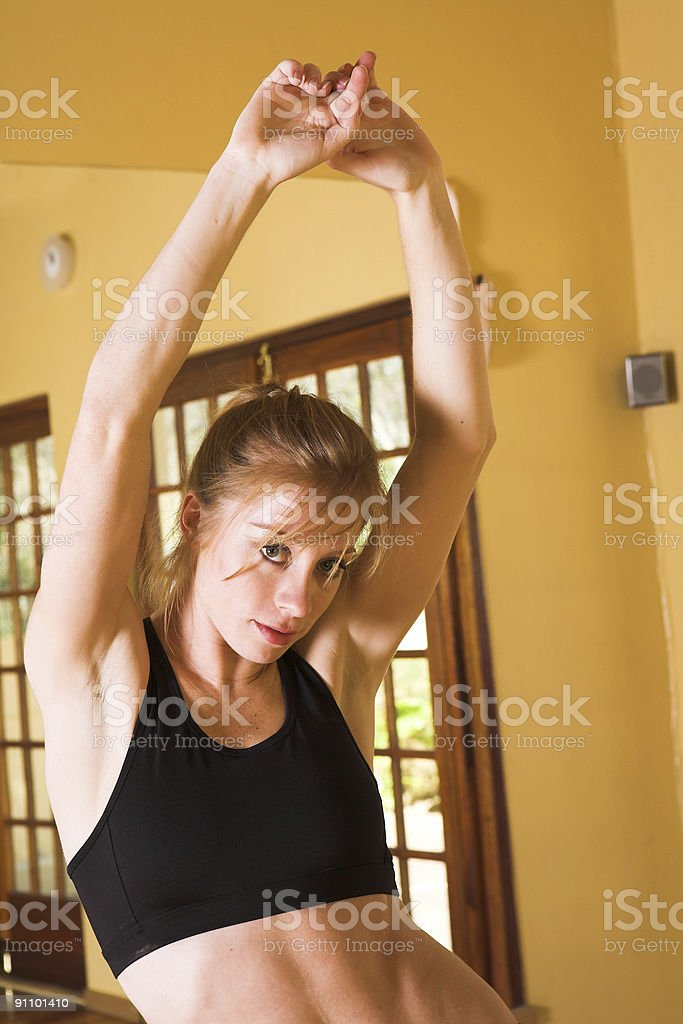 Sexy dancer in black top and bare belly royalty-free stock photo